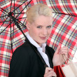 Portrait of a young woman with umbrella — Stock Photo #11052104