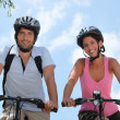 Couple on bicycle — Stock Photo #11052738