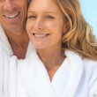 Couple on vacation wearing bathrobes — Stock Photo #11052979