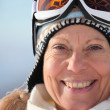 Stock Photo: Mature woman in a trendy ski hat and mask