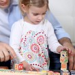 Father and daughter playing with building blocks — Stock Photo