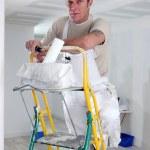 Painter climbing ladder — Stock Photo