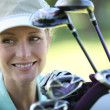 Woman amateur of golf — Stock Photo