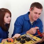 Man teaching apprentice how to cut tube — Stock Photo
