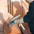 Craftsman mason cleaning bricks — Stock Photo