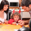 Little boy dressed ad devil with his parents — Stock Photo #11056094