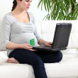 Pregnant woman making a payment online - Foto de Stock