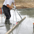 Mason smoothing concrete — Stock Photo