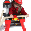 Stock Photo: Little boy playing with carpentry toy