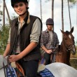 Couple riding horses together — Stock Photo #11057566