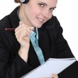 Call center employee holding a notepad — Stock Photo