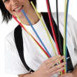 Woman holding pipe cleaners — Stock Photo #11058972