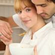Couple eating bowl of cereal — Stock Photo #11059683