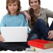 Royalty-Free Stock Photo: Young with a laptop computer