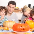 Family decorating pumpkins — Stock Photo #11059929