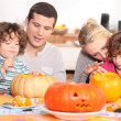Stock Photo: Family decorating pumpkins