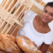 Baker and her bread — Stock Photo #11059976
