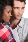 Interracial couple side by side — Stock Photo