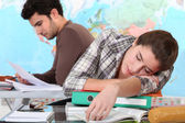 Student sleeping on her desk — Stock Photo