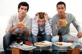 Boys eating burgers — Stock Photo