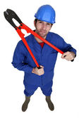 Construction worker holding large pliers — Stock Photo