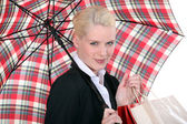 Portrait of a young woman with umbrella — Stock Photo