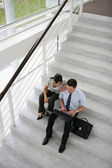 Business on a stairwell — Stock Photo