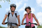 Couple on bicycle — Fotografia Stock