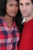 Serious mixed race couple — Stock Photo