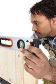 Craftsman working with level — Stock Photo