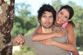 Tanned couple outdoors — Stock Photo