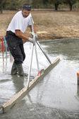 Mason smoothing concrete — Stock Photo