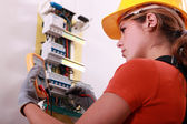 Woman measuring electrical current — Stock Photo