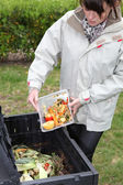 Woman making compost from old vegetables — Stock Photo