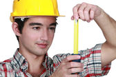 Builder holding tape measure — Stock Photo