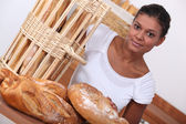A baker and her bread — Stock Photo