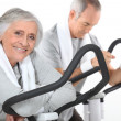 A mature couple exercising. — Stock Photo