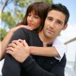 Beautiful couple embracing — Stock Photo #11061300