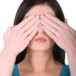Brunette woman with her hands over her eyes — Stock Photo #11061449
