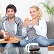 Stock Photo: Couple having breakfast on couch