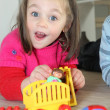 Stock Photo: Young child playing with her toys
