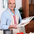 Stock Photo: Elderly mcooking