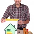 Stock Photo: Male carpenter promoting energy savings.