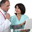 Stock Photo: Two hospital workers with laptop