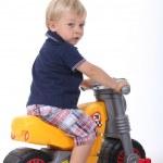 Boy on a toy motorbike — Stock Photo #11062982