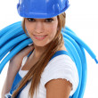 Woman carrying coil — Stock Photo