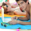 Boy on beach with computer — Stock Photo #11064408