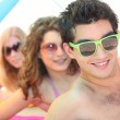 Youth on the beach wearing sunglasses — Stock Photo #11065115