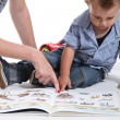 Mother and child looking at a book — Stock Photo #11066070