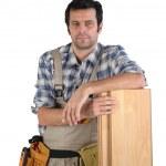 Man stood with laminate floor panels — Stock Photo #11066083